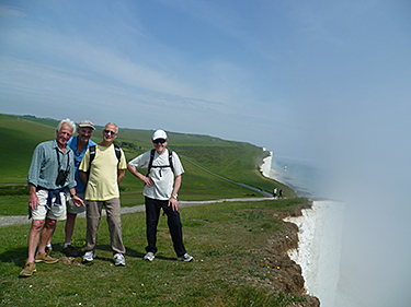 Walkers at cliff edge